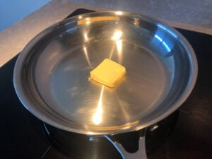 Butter in a stainless steel pan