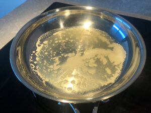 Heating butter in a frying pan