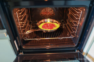 Baking a pizza pie in a stainless steel frying pan