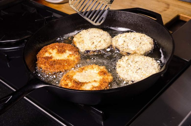 Photo of fritters in a cast iron skillet