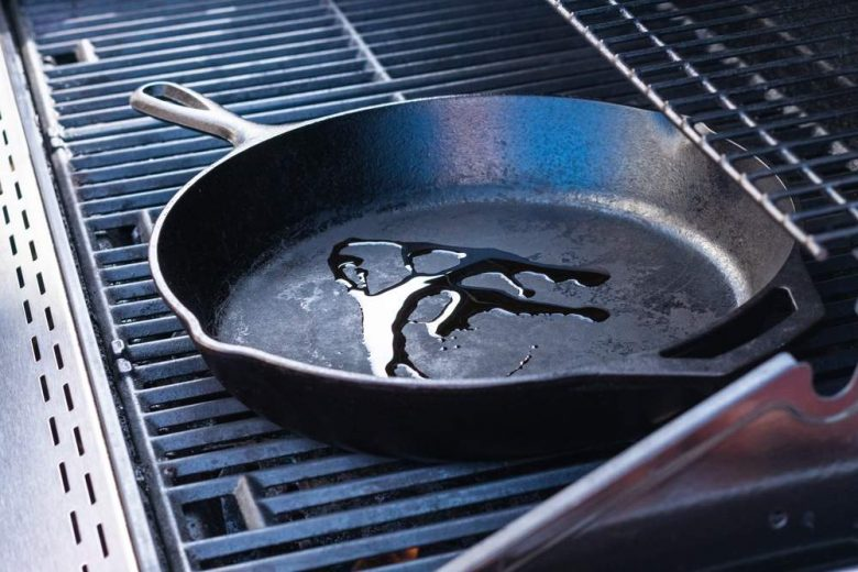 Photo of a cast iron skillet with oil in it