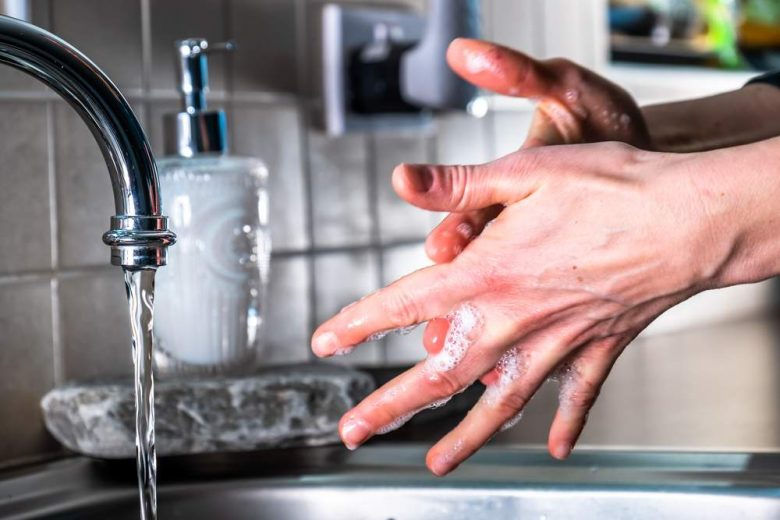 Photo of a cook washing their hands