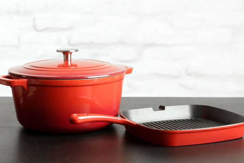 Photo of a Dutch oven alongside a grill pan