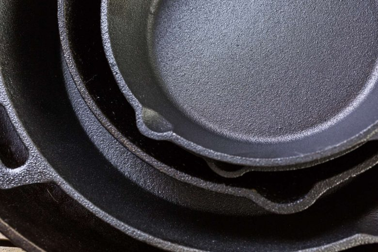 Photo of stacked cast iron skillets