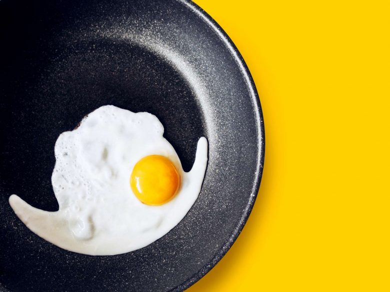 Photo of an egg being fried in a non-stick skillet
