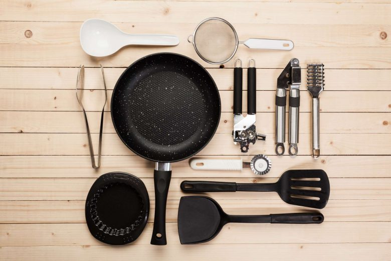 Photo of a non-stick pan with utensils and kitchen equipment